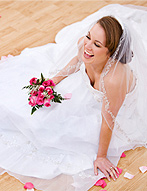 Beautiful bride posed in sitting position on the dance floor